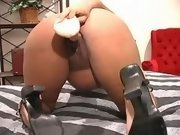 Pregnant ebony chick gets dildofuck